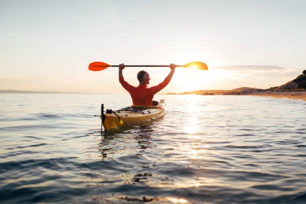Sunset kayaking stock photo