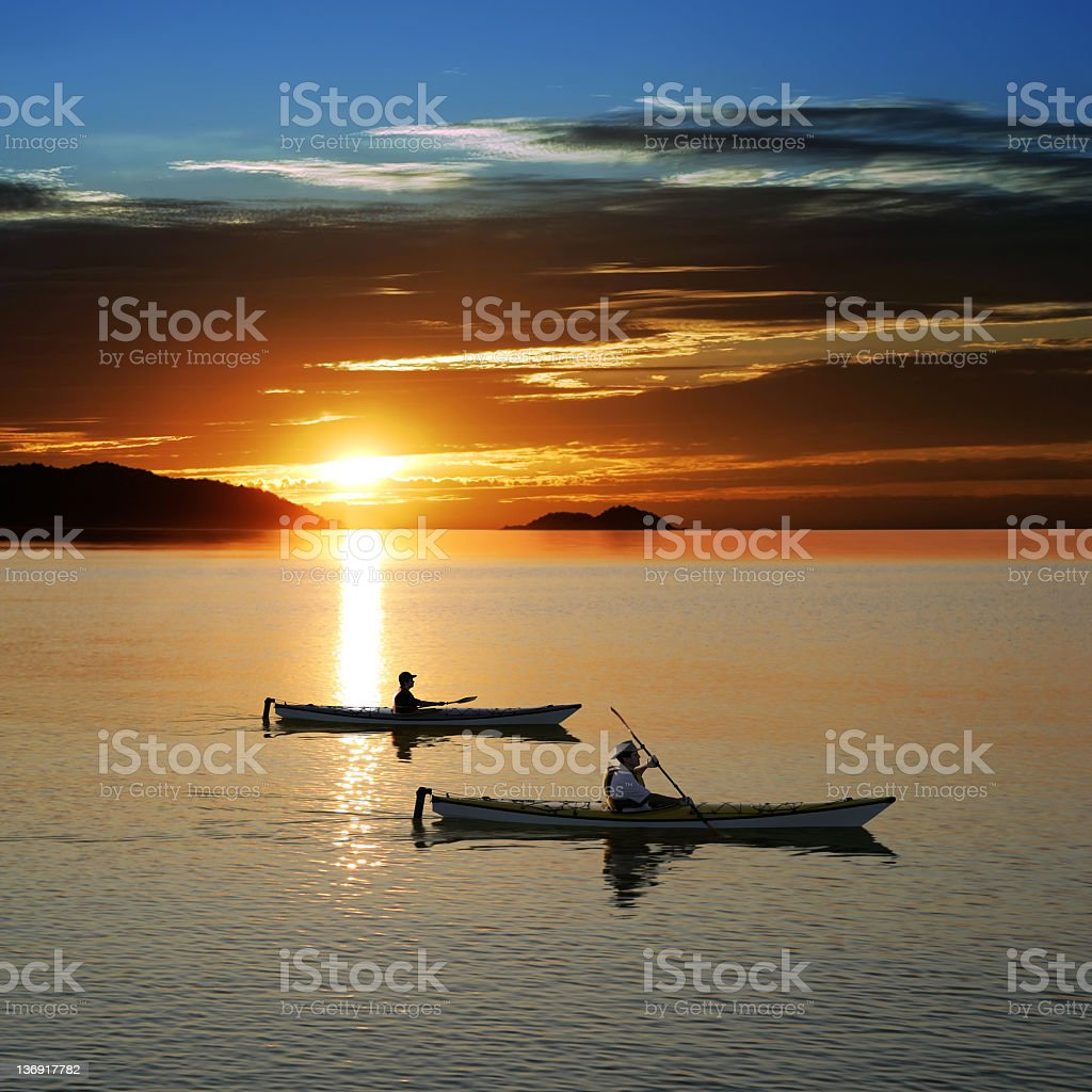 sunset kayaking royalty-free stock photo