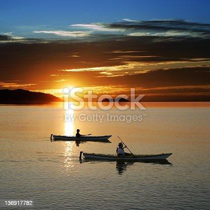 184332102istockphoto sunset kayaking 136917782