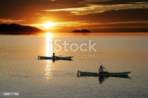 184332102istockphoto XL sunset kayaking 136917783