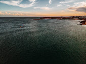This is Kite Foiling at Praia do Martinhal, Sagres, Portugal\nKite surfing and Kite boarding as well as foiling are getting more and more popular besides surfing. Portugal is the place-to-be in Europe to be able to do it the whole year. Here are some amazing shots taken by a drone.