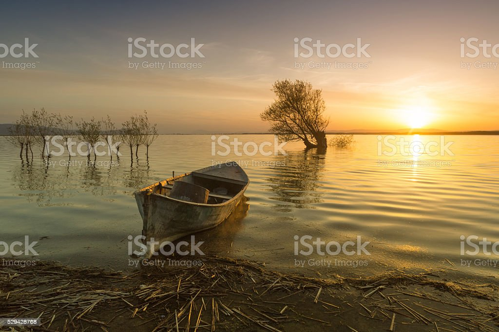 Sunset, Lake and Boat stock photo