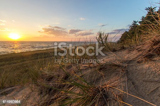 832047798 istock photo Sunset Lake Horizon And Sand Dunes 614992664