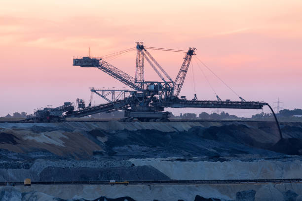 Sunset landscape brown coal open pit with digging machine, Germany Sunset landscape brown coal open pit with digging machine in Hambach mine Germany tagebau stock pictures, royalty-free photos & images