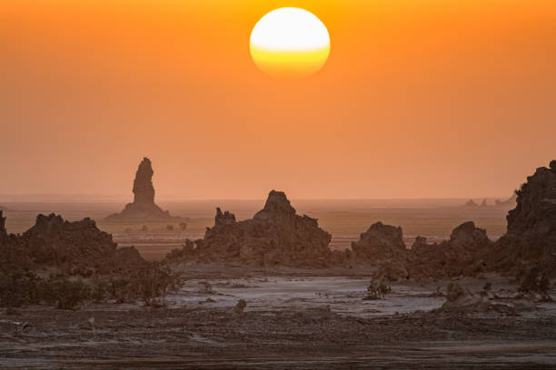 Sunset landscape with limestone chimneys at Lake Abbe Djibouti Stock photograph of limestone chimneys at Lake Abbe, Djibouti at sunset. lake bed stock pictures, royalty-free photos & images