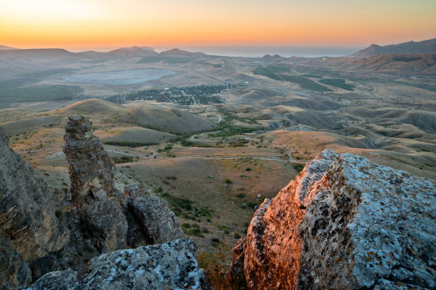 Sunset landscape with rocks and valley stock photo