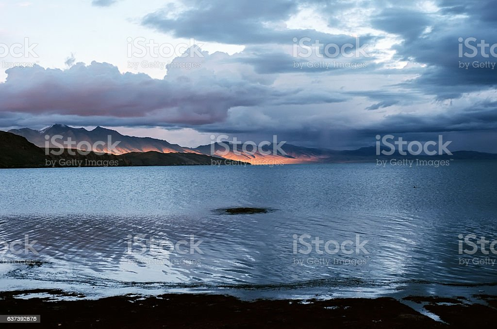 Sunset light at the sacred Lake Manasarovar. stock photo