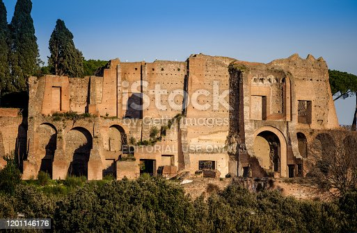 Rome, Italy, January 15 -- The light of sunset illuminates the Palatine Hill, seen from the Circus Maximus. The Palatine Hill was a sacred place for the Romans where, according to tradition, the city was founded. The Roman emperors Augustus, Tiberius and Domitian built their immense palaces on this hill, the remains of which are visited by millions of tourists every year. Image in HD format.