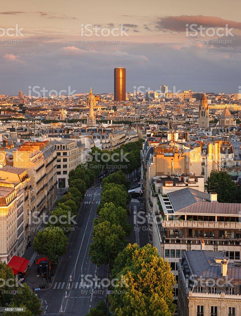 Sunset light on Montparnasse Tower, Avenue Marceau rooftops, Paris, France stock photo