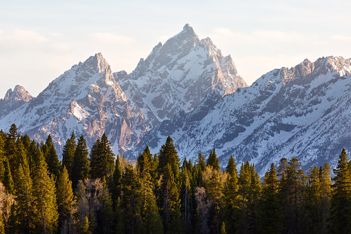Scenic landscape with sunset light on the snowcapped mountains in Grand Teton National Park, Wyoming, USA