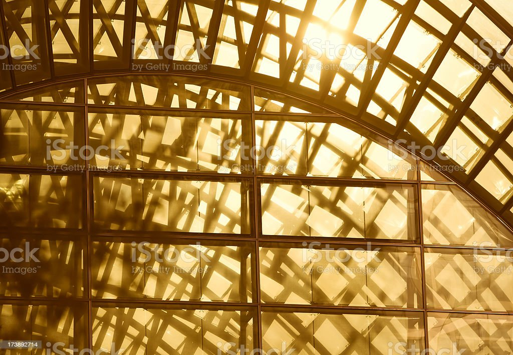 Sunset Light Streaming Through Glass Roof stock photo
