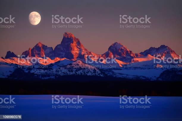 Sunset light with alpen glow on tetons tetons mountains rugged with picture id1095992076?b=1&k=6&m=1095992076&s=612x612&h= v7ez1lj30nrqf2nccc8zrt stwwrna k2qfn1y2nqi=