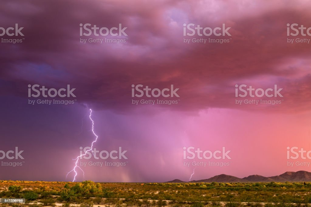 Sunset lightning storm with pink sky stock photo