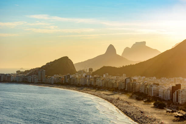 Sunset lights between Copacabana buildings stock photo