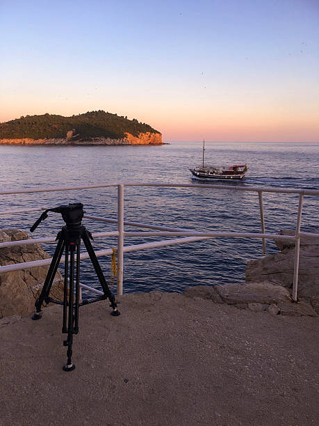 Sunset Lokrum from Dubrovnik with tripod and a boat ストックフォト