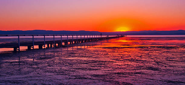 sunset long jetty - low contrast stock pictures, royalty-free photos & images