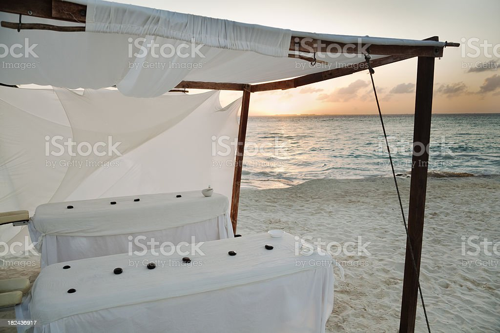 Sunset Massage by the Caribbean Sea stock photo