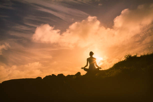 Sunset meditation stock photo