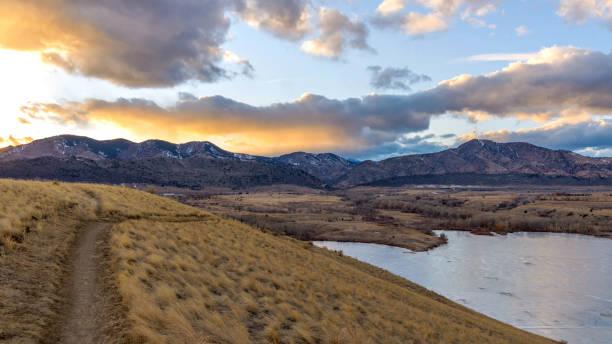 Sunset Mountain Park - A panoramic winter sunset view at Bear Creek Park. CO, USA. stock photo