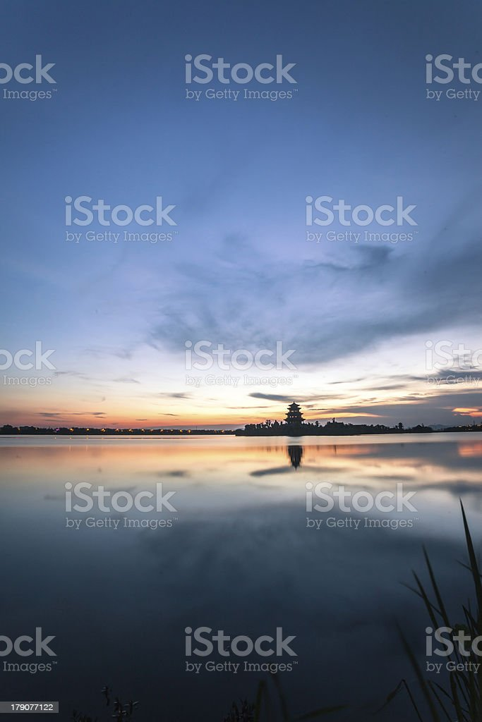 sunset near lake with ancient chinese tower building royalty-free stock photo