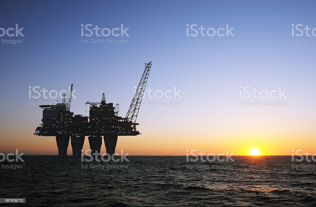 sunset offshore platform stock photo