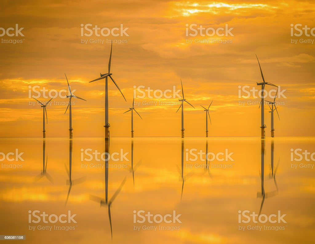 Sunset Offshore Wind Turbine in a Wind farm stock photo