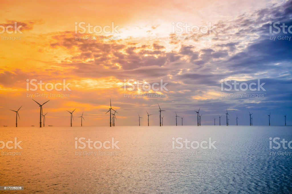 Sunset Offshore Wind Turbine in a Wind farm under construction of England coast, UK stock photo