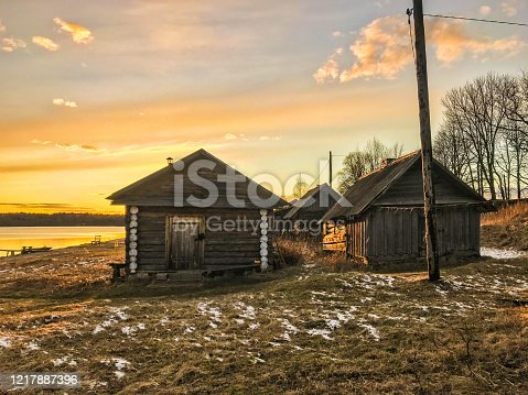 istock Sunset. Old wooden house in Russian village. 1217887396