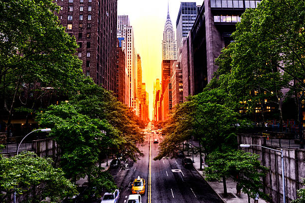 sunset on 42nd street, nyc - chrysler building stock photos and pictures