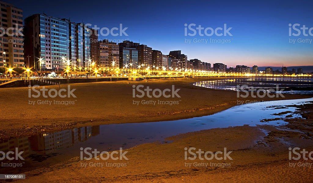 sunset on a city beach stock photo
