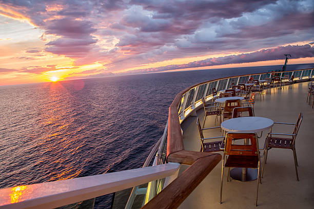 sunset on a cruise ship - cruise ship stock photos and pictures