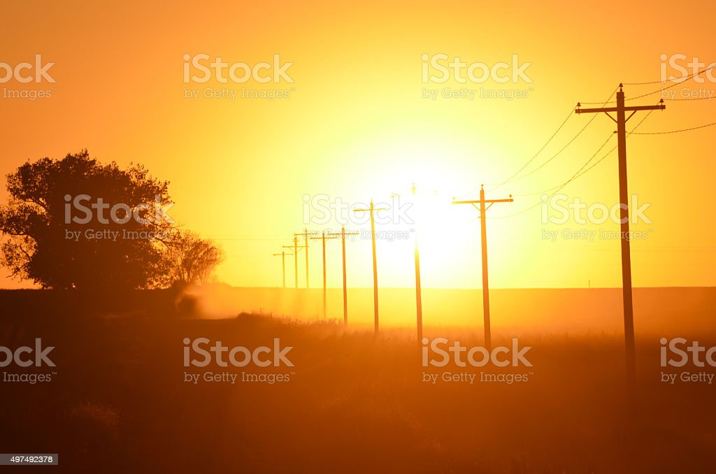 Sunset on a DirtRoad stock photo