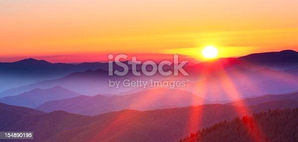 istock Sunset on a foggy mountain range 154890195