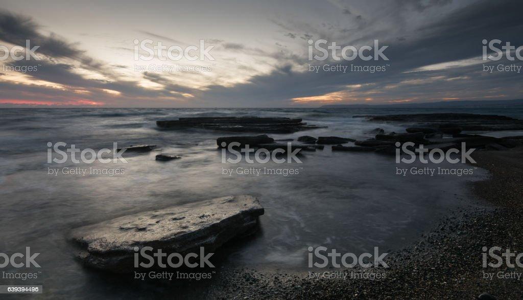 Sunset  on a rocky coastline stock photo