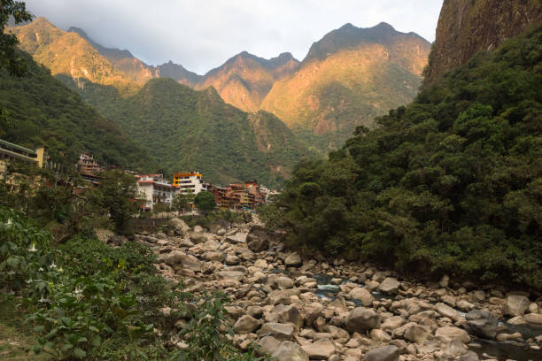 Sunset on Aguas Calientes town seen from the end of the Salkantay Trek stock photo