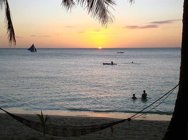 Sunset on beach with hammock in Boracay Philippines stock photo