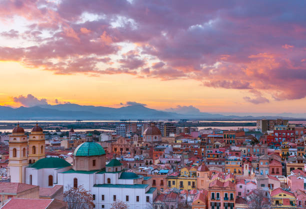 Sunset on Cagliari, evening panorama of the old city center in Sardinia Capital, view on The Old Cathedral and colored houses in traditional style, Italy stock photo