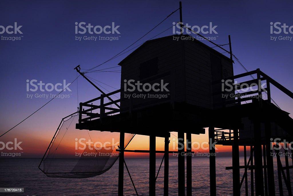 Sunset on carrelet fishing stock photo