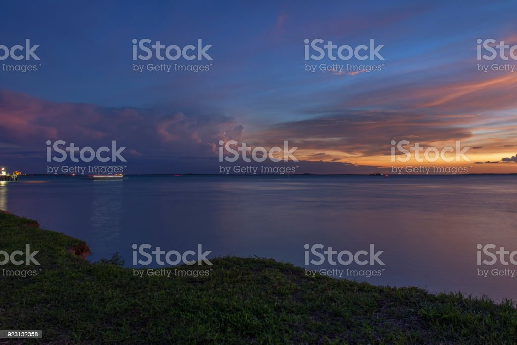 Sunset on Darwin Harbour with lightning stock photo