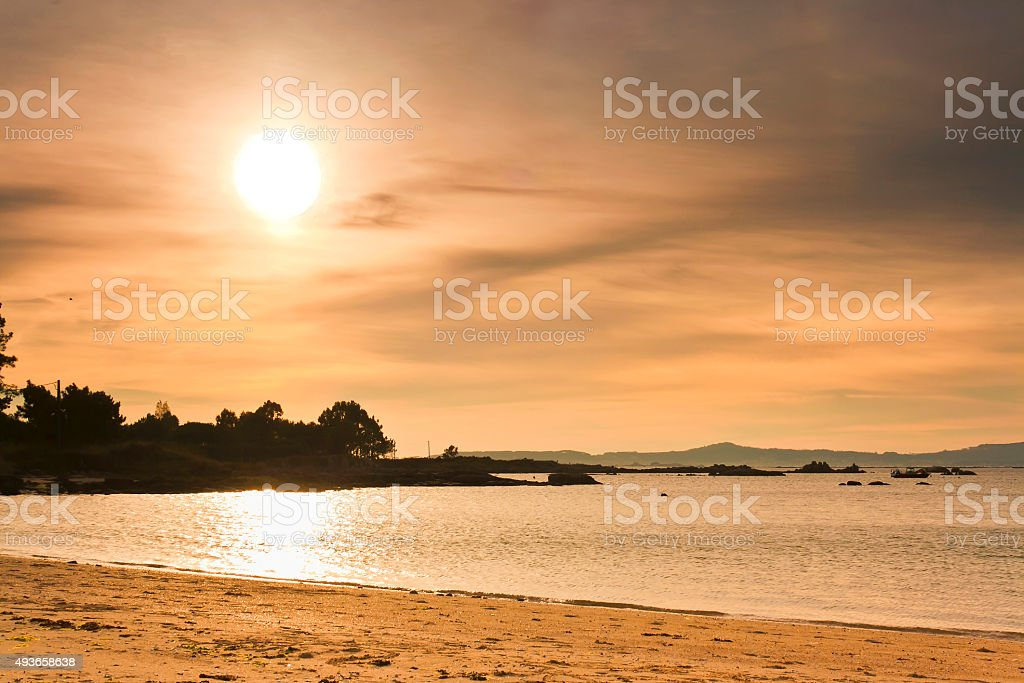Sunset on Espineiro beach stock photo