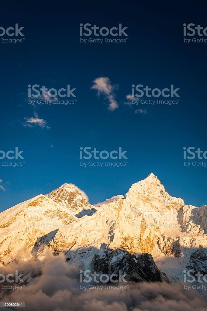 Sunset on Everest summit under high altitude skies Himalayas Nepal stock photo
