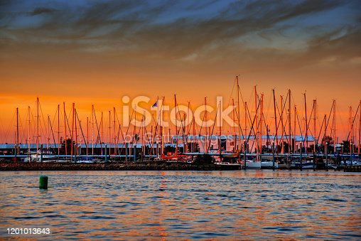 The beautiful colors of sunset beyond a marina on Galveston Bay just south of Houston, Texas.