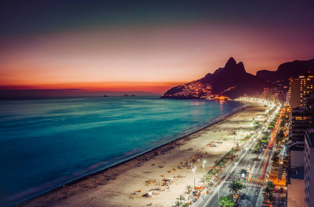 Sunset on Ipanema Beach and coastline street, Rio de Janeiro Sunset on Ipanema Beach and coastline street, Rio de Janeiro, Brazil lagoa rio de janeiro stock pictures, royalty-free photos & images