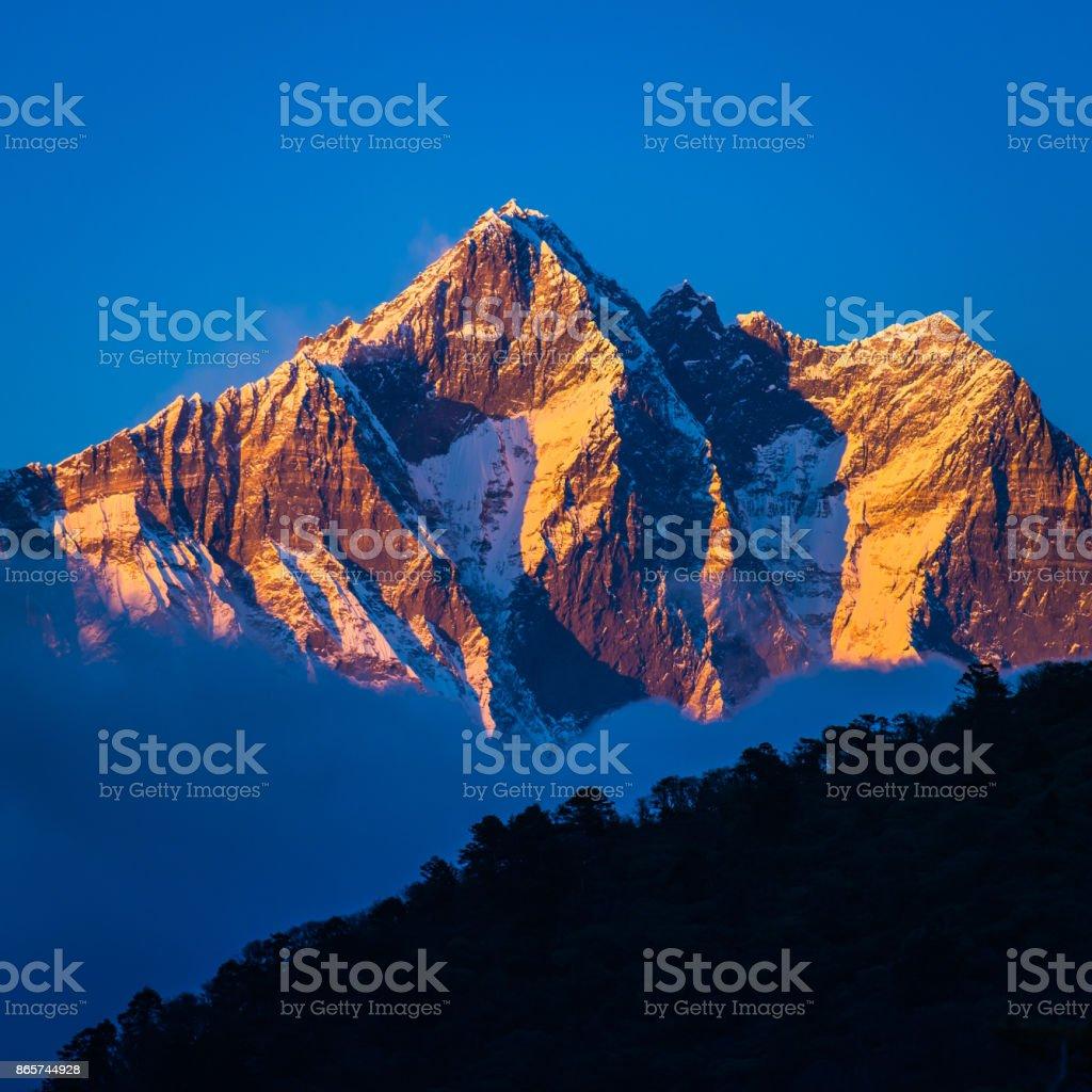 Sunset on Lhotse 8516m Himalaya mountain peak Khumbu valley Nepal stock photo