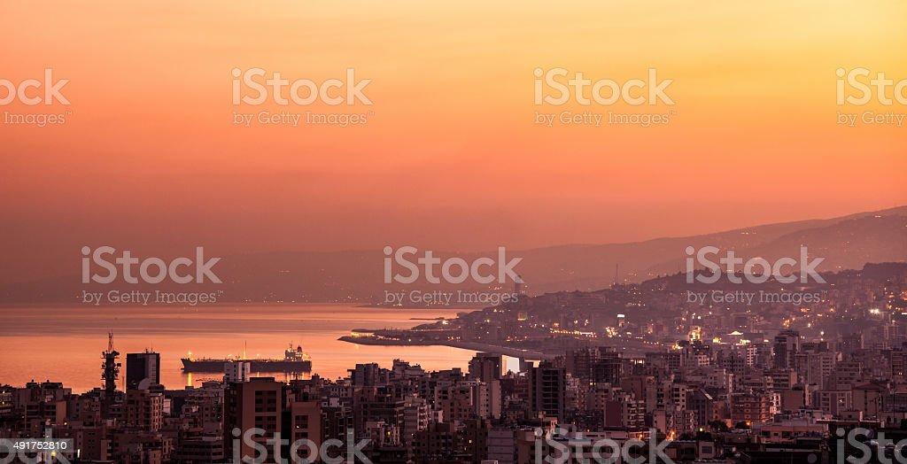 Sunset on mountain city stock photo