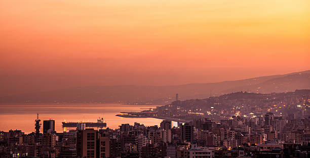 Sunset on mountain city Beautiful red sunset on mountain city, evening cityscape, mediterranean sea, travel and tourism concept beirut stock pictures, royalty-free photos & images