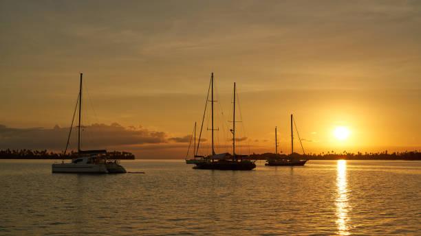 Sunset on paradise uninhabited islands at Caribbean sea stock photo