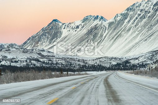 1066508460 istock photo Sunset on Remote Alaska Highway With Snow Capped Mountains 638293732