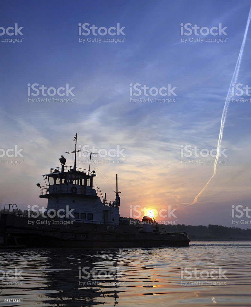 sunset on river and ship royalty-free stock photo