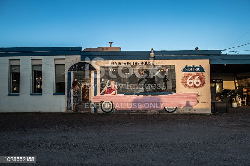 New Mexico, August 3, 2018. Preserved motel on Rout66 with Elvis and Cadillac commemorative mural.